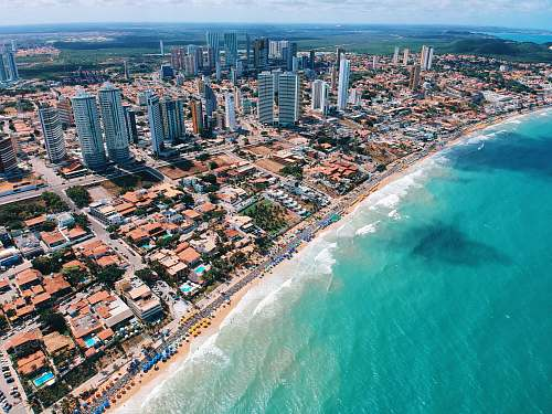 scenery aerial photography of city building near the seashore during daytime outdoors