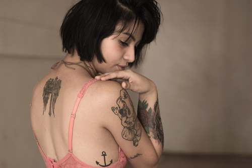 woman standing woman wearing pink bra with tattoos tattoo