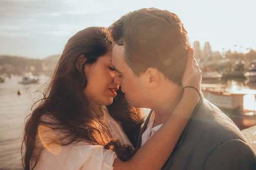 kiss man and woman kissing beside bay couple