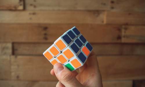 rubix cube person holding 3x3 Rubik's Cube game