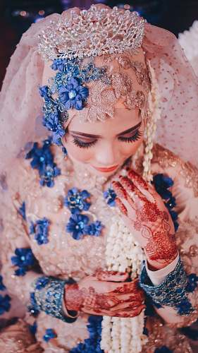 human woman wearing pink and blue floral wedding abaya person