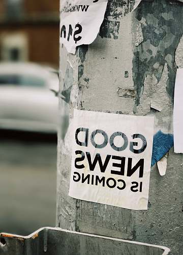 sticker white Good News Is Coming paper on wall sign