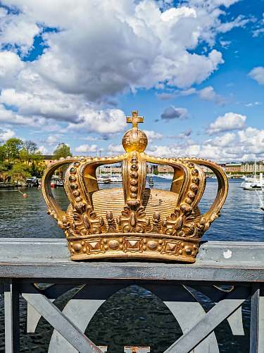 waterfront gold crown with a cumulus clouds in the background dock