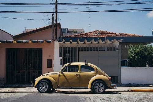 car beige Volskwagen Beetle parked outside house transportation