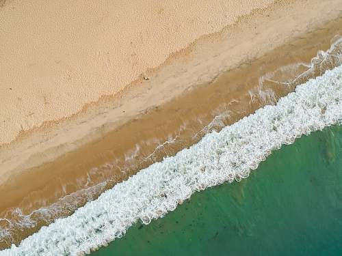 nature aerial photo of seashore during daytime beach