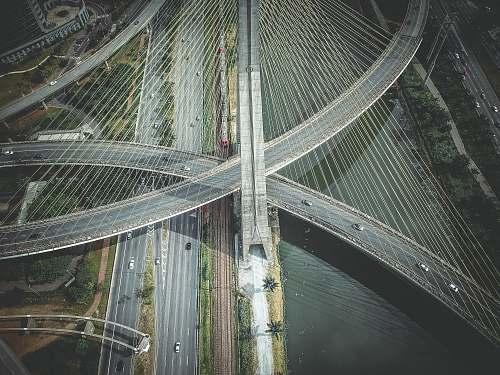 grey aerial view of concrete road and bridge bridge