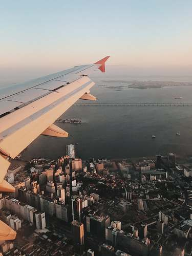 airplane aerial view of plane wings and view of high-rise buildings scenery