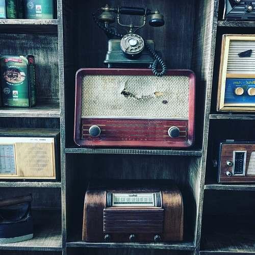 vintage black rotary telephone on red transistor radio phone