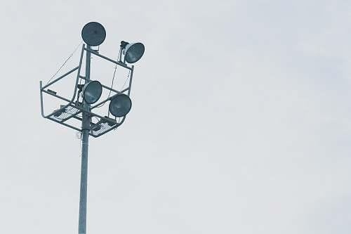 light gray megaphones on gray metal post grey
