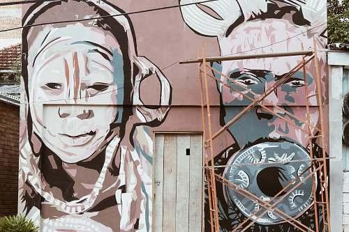 graffiti scaffolding placed in front of wall with graffiti porto alegre