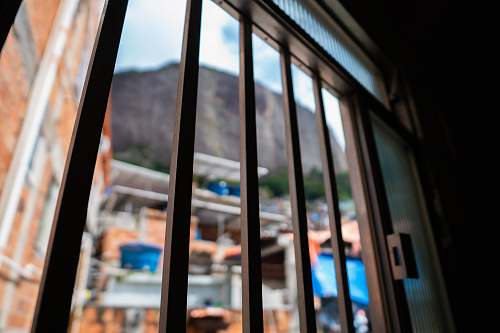 window selective focus photography of brown metal frame rio de janeiro