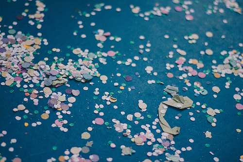 confetti selective focus photography of paper dot paper