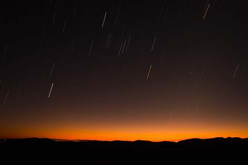 nature silhouette of hill during night time sky