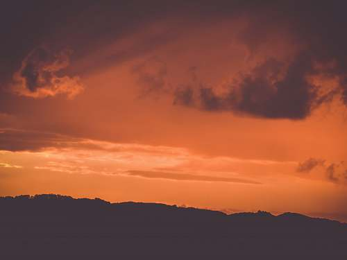 nature silhouette of mountains during golden hour sunset