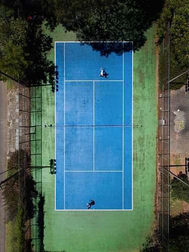 blue two men playing tennis curitiba