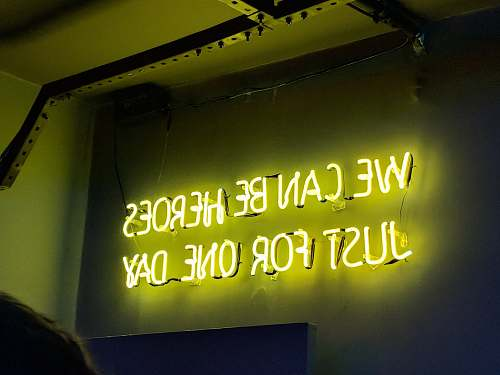 neon yellow neon light signage quote