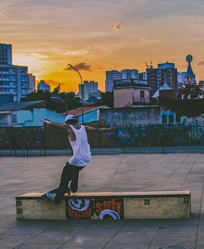 person man doing tricks on skateboard brazil
