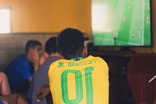 people man wears yellow and green jersey shirt person