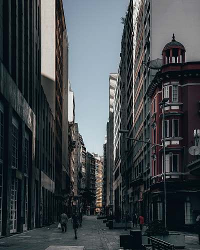 person person walking between buildings path