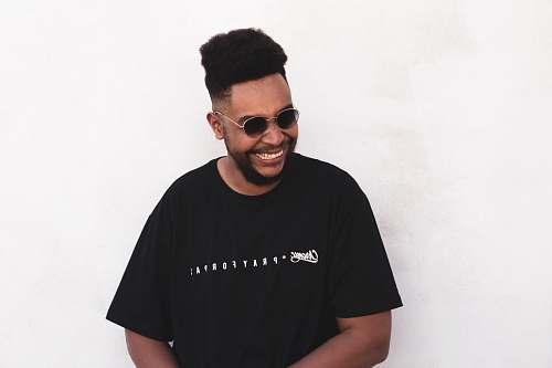 person smiling man wearing black t-shirt people