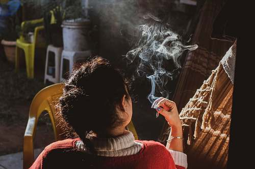 person woman holding cigarette people