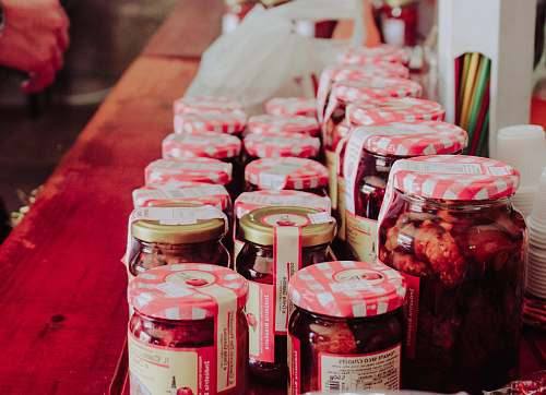 food clear glass jars on brown wooden table human
