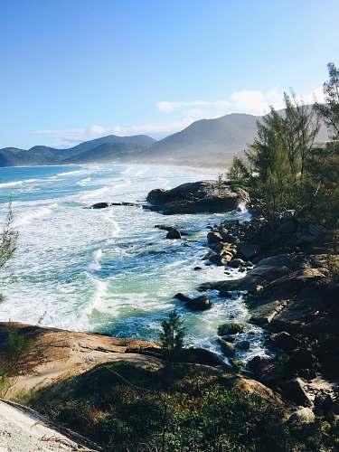 ocean photo of seashore and mountain scenery promontory