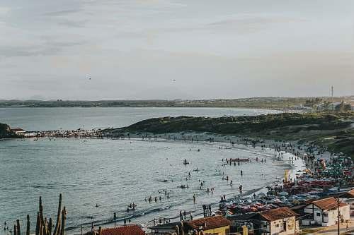 sea people on beach water