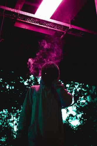 person person holding cigarette human