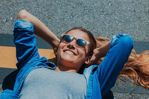 people smiling woman lying on concrete pavement human