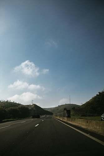 tarmac asphalt road under blue sky asphalt