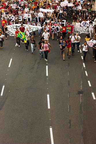 brazil people rallying on road during daytime crowd