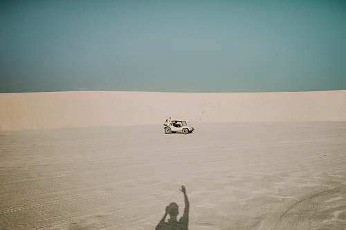 nature white ATV passing through dunes soil
