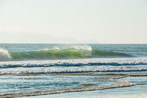 beach ocean waves crashing to shore ocean