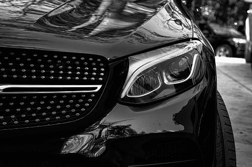 car grayscale photo of cars headlight automobile