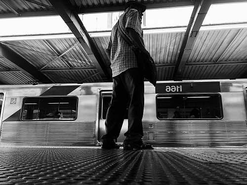 banister man standing on the train station handrail