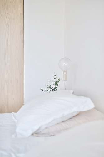 pillow white bed pillow near table lamp cushion