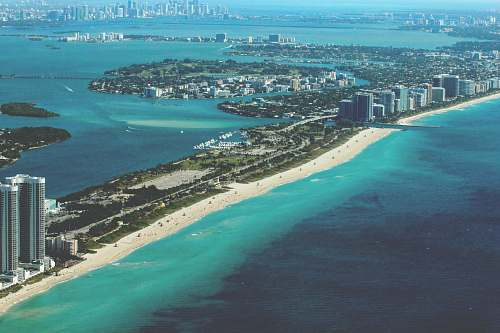 miami aerial photography of city at daytime ocean