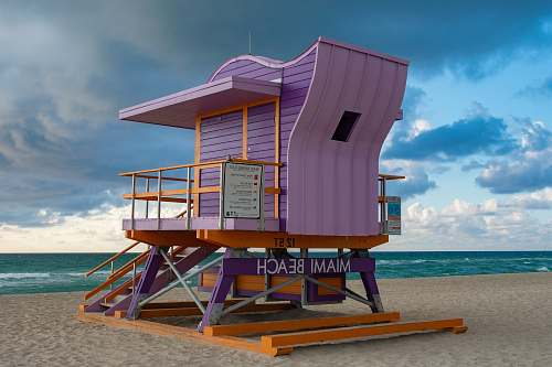 building purple and brown wooden Miami Beach cottage by the beach countryside