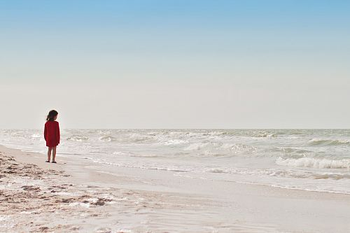 photo girl standing on seashore during daytime free for commercial use images