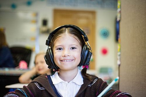 photo girl wearing black headphones free for commercial use images