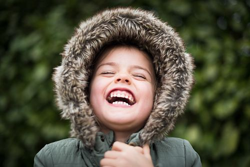 photo selective focus photography of child laughing free for commercial use images