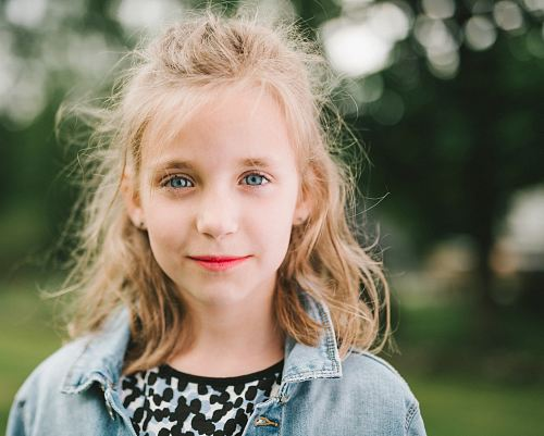 smiling girl in blue denim jacket