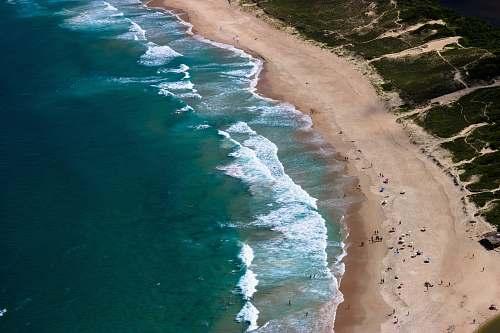 coast aerial photo of people at seashore nature
