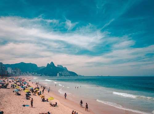 ocean group of people sunbathing on beach water