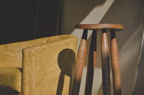 wood brown wooden stool near barrel chair hortolândia