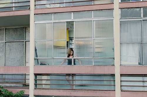 grey woman looking thru windows state of são paulo