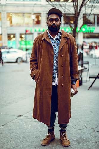 people man standing on road near bare tree coat