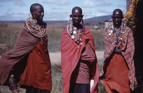 people three women wearing capes outdoors tribe
