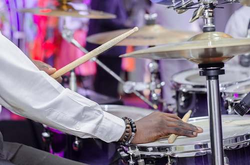 musician man playing drum set musical instrument